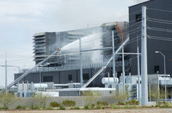 Industrial Fire 2. Fighting a fire in the cooling tower at an electricityl generating plant Stock Image
