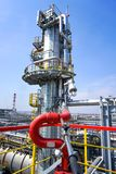 Industrial fire hydrant aimed at the technological equipment of the refinery stock photo