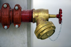Industrial fire hydrant installed on concrete column Royalty Free Stock Photo