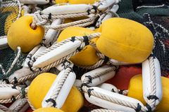 Industrial fishing net. Industrial fishing net with large yellow floats royalty free stock photography