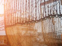 Industrial fishing nets are dried in port near ship royalty free stock photos