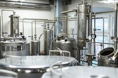 Industrial food equipment, industrial distillers of alcohol. Clean, chrome equipment royalty free stock photo