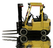 Industrial forklift. Empty industrial forklift with reflection in water Stock Photo