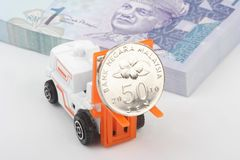 Industrial forklift carrying Malaysia currency Stock Image