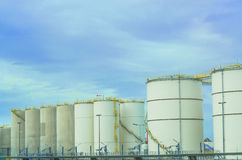 Industrial fuel Depos. Several large white industrial fuel tanks for petrol and oil Royalty Free Stock Images