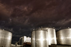 Industrial fuel storage towers Royalty Free Stock Images