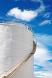 Industrial fuel tank. Against blue sky Stock Images