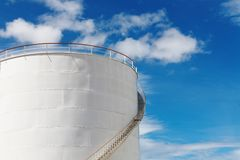 Industrial fuel tank. Against blue sky background Royalty Free Stock Image