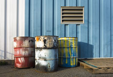 Industrial 55 gallon drums. Colorful industrial 55 gallon drums royalty free stock photography