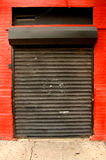 Industrial Garage door. A metal roll up industrial garage door royalty free stock image