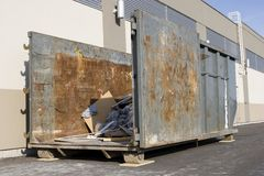 Industrial garbage container on construction site Royalty Free Stock Photo