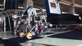 Industrial garment factory equipment in working process stock video