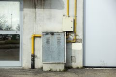 Industrial gas meter yellow box and pipes.  stock photography