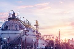 Industrial. Gas storage spheres tank in oil refinery plant on sky sunset background Royalty Free Stock Photo