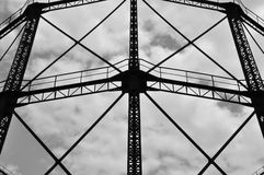 Industrial gasholder. Frame iron structure exterior abstract architecture. Black and white stock photo