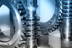 Industrial gear and a circular gear, cogwheel. Blue toned. Industrial gear and a circular gear, cogwheel with spiral teeth. Blue toned image. Macro shooting royalty free stock photos