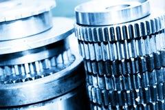 Industrial gear, cogwheels in workshop. Industry Stock Image