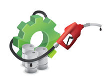 Industrial gear with a gas pump nozzle Royalty Free Stock Photography