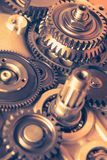 Industrial gear wheels. Golden tone, close-up view Royalty Free Stock Photography