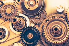 Industrial gear wheels. Golden tone, close-up view Stock Image