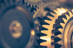 Industrial gear wheels. Golden tone, close-up view Royalty Free Stock Images