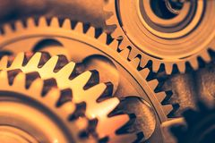Industrial gear wheels. Golden tone, close-up view Stock Photography