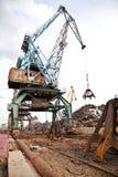 Industrial grabber  loads scrap metal Royalty Free Stock Images