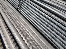 Industrial Grade Reinforcing Steel Bars Background. Dark Color Metallic Industrial Grade Reinforcing Steel Bars Background Stock Image