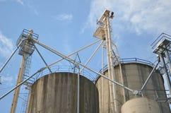Industrial grain silos. Against blue sky stock photo