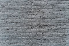 Industrial gray brick wall background in Europe. May be used in design and interiors stock images