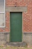 Industrial green door Stock Photography