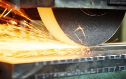 Industrial grinding. finishing metal surface on horizontal grinder machine Stock Photos