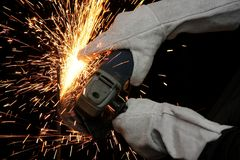 Industrial Grinding Orange Sparks Stock Photo