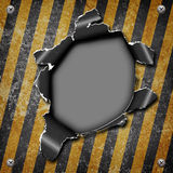 Industrial grungy steel plate. With black and yellow strip and hole Royalty Free Stock Photography