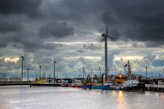 Industrial harbor landscape with dark sky Stock Photos