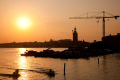 Industrial harbor at sunset and a crane Royalty Free Stock Image