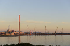 Industrial harbor at sunset. Royalty Free Stock Photos