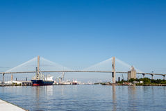 Industrial Harbor Under Suspension Bridge Stock Images