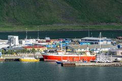 Industrial harbour in Isafjordur, Iceland with a lot of ships. ISAFJORDUR, ICELAND - JULY 7, 2014: Industrial harbour in Isafjordur, Iceland with a lot of ships Stock Images
