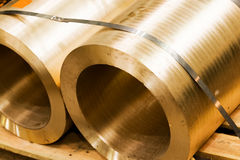 Industrial hardened steel cylinders in workshop. Industry. Stock Photos