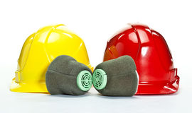Industrial hardhats and respirators Stock Photos