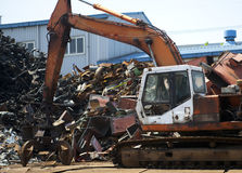 Industrial heap of  metal and excavator Royalty Free Stock Photos