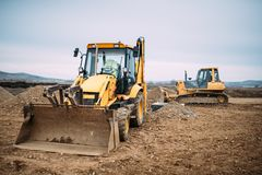 Industrial backhoe excavator loader and bulldozer machinery on construction site Royalty Free Stock Photos