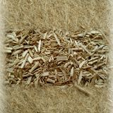 Industrial Hemp - Raw Fibers. This is raw processed hemp; the center being what most call Hemo Shiv aka Hurd. The surrounding hemp is raw fibers in a non-woven stock photo