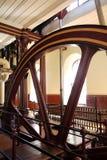 Industrial heritage: historic steam pump wheel v Stock Photo