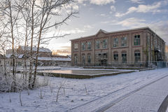 Industrial heritage. Old abandoned factory in the early winter morning Royalty Free Stock Photography