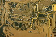 Industrial hi tech circuit background. Industrial hi tech green circuit background with golden electric paths Stock Images