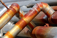 Rusty industrial hoses. Industrial hoses with rust on the whole surface stock photo