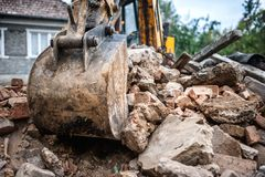 Industrial hydraulic backhoe bulldozer loading demolition debris Stock Images