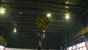Industrial indoor crane hook on a rail. Fly around shot by steadycam stock video